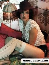 Milla Jovovich In Stockings